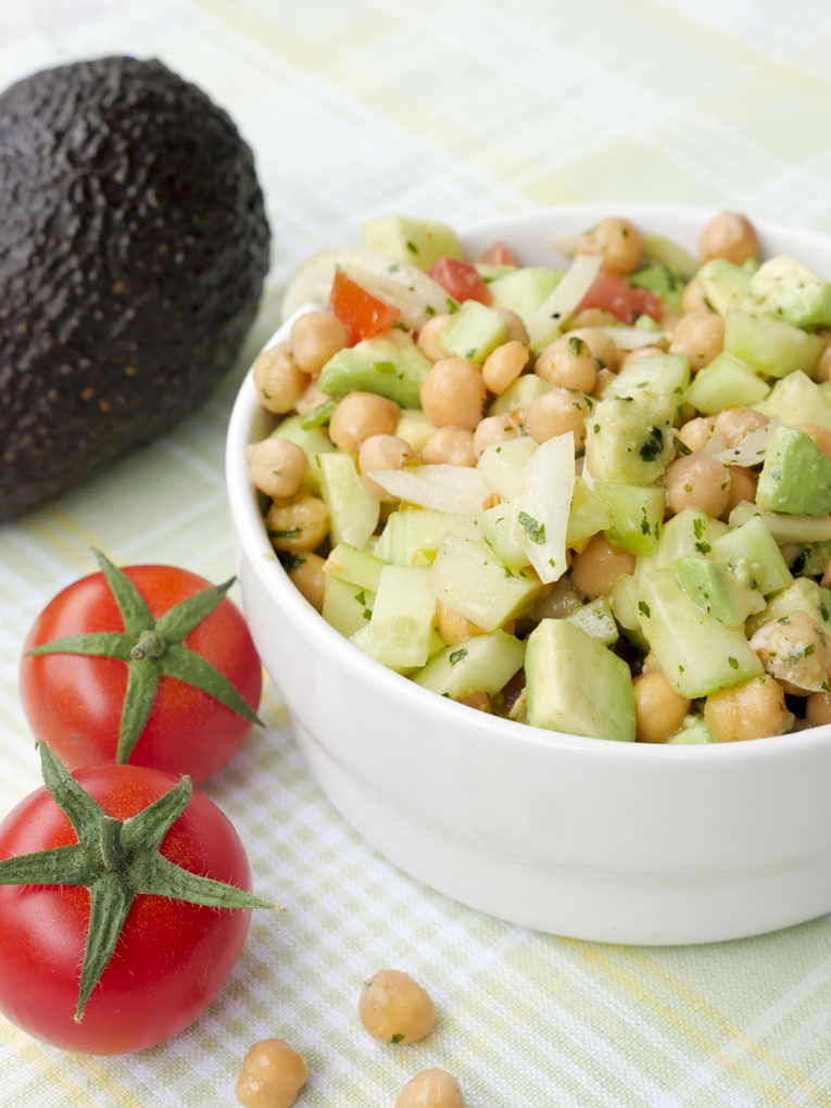 Fast low carb chickpea salad with avocado, cucumber and tomato