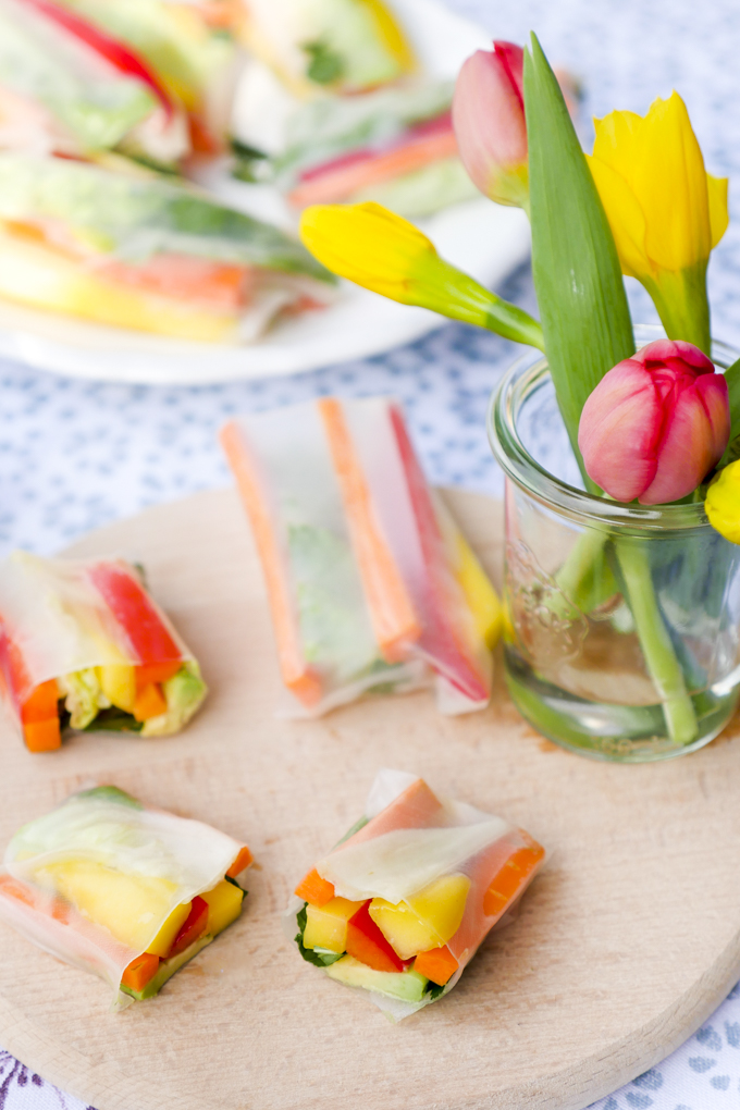 Fast vegetarian summer rolls with mango, avocado, peppers and carrots